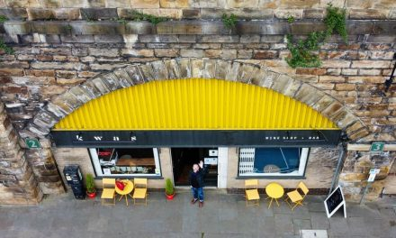 Hoults and Kwas raise a glass to life underneath the Arches