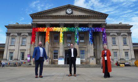 Former Great British Sewing Bee star Stuart Hillard unveils yarn bombing of Huddersfield Railway Station