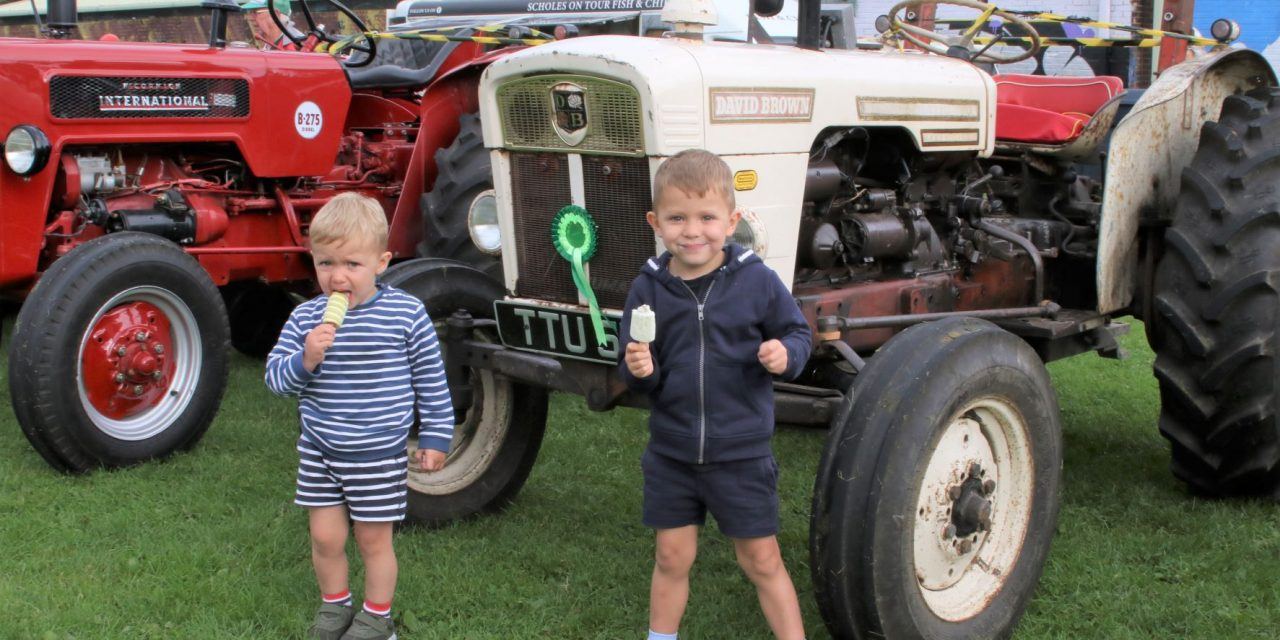Fun, sun, ice cream and tractors – 12 great pictures by Sean Doyle from Honley Show Centenary Event