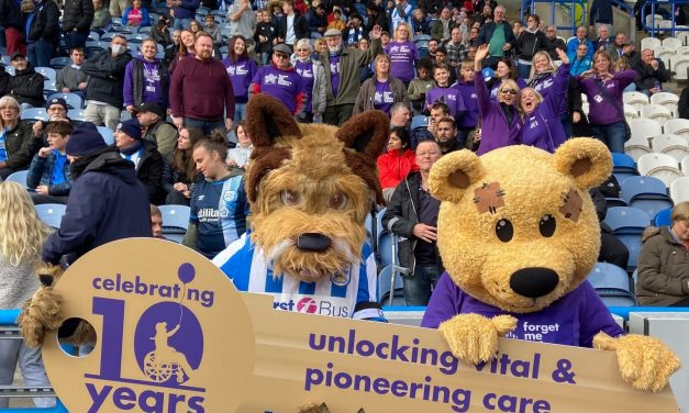 Giant key unlocks Forget Me Not's 10th birthday celebrations at Huddersfield Town game